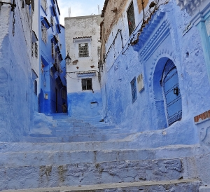 The blue washed streets are restful to the eye after the starker white villages of Andalucia