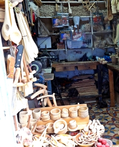 There are hundreds of little workshops honeycombing the narrow streets of the Medina. Carpenters, silversmiths, tailors, loom weavers, shoemakes and so on. This is a handcarver's workshop selling walking sticks, honey pots, bowls, kitchen utensils and knife handles