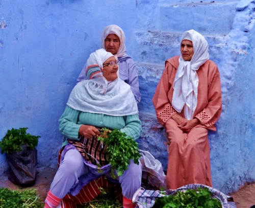 Women selling mint and coriander in the medina at Chefchouen